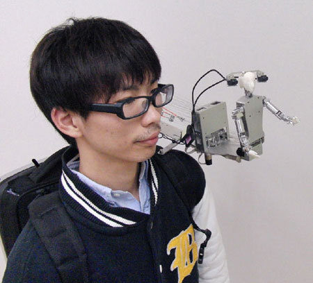 emergentfutures:  Japanese MH-2 Shoulder Robot Wants To Be Your Friend, Literally   the MH-2 wearable miniature humanoid lives on your shoulder and can be remotely inhabited by your friends from anywhere in the world.  Full Story: IEEE  Forget Skype … next time you travel, bring a friend on your shoulder, via robot!