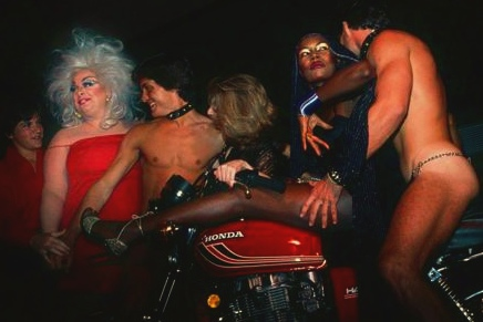 daveboogie:  Divine & Grace at her 30th birthday party. We need more motorcycles in clubs these days…FUN!