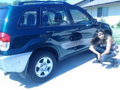 This tis' I being a cholo/Hair model in front of my newly acquired car.This car is one sick as fother mucking piece of machinery. yeeee. This is going to be the best summer ever yo.
