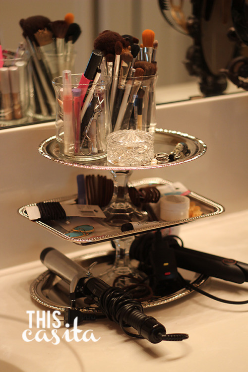 Repurposed trays and candlestick holders make fabulous accessory and make up storage. I doubt you could thrift these cheaper than the dollar store sells them, but for the same price you could definitely get some unique items with a nice patina to them at the thrift shoppe.