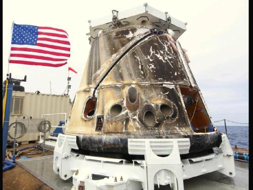SpaceX's Dragon capsule sits on a barge after being retrieved from the Pacific Ocean after splashdown. (via NASA)