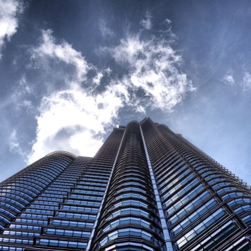One of the Petronas Twin Towers. Epic. #malaysia #tower #sky #clouds #blue #architecture (Taken with instagram)