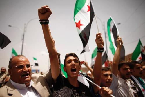 Syrians living in Yemen shout slogans against Syria's President Bashar Al-Assad during a rally in Sanaa June 1, 2012. The rally was held to condemn last week's massacre of more than 100 people in the Syrian town of Houla, which the United Nations said appears to have been the work of the Syrian army and pro-Assad militiamen. Damascus blamed the atrocity on the rebels.
