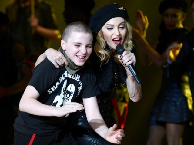 Madonna's 11 year old son Rocco Ritchie hamming it up with his famous Mommy.