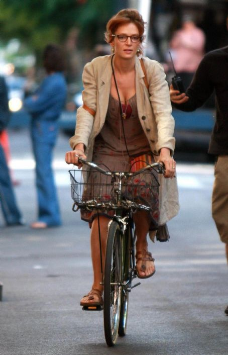Uma Thurman riding a bicycle