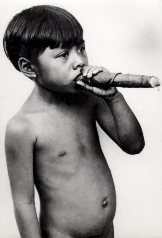 A young boy smoking a cigar, Philippines, 1931.  Source: Nationaal Archief