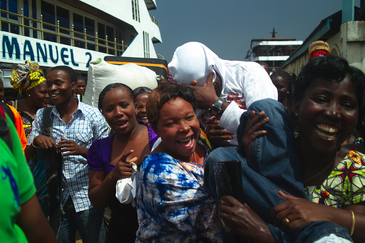 The boat from Goma to Bukavu, takes about 6 hours, there are faster speed boats, but i chose to take the big boat, actually a ferry which departs form Goma at around 7am in the morning. Emanuel 2  - was the ferry i was going to take. it had 4 levels. the top level was the first class level , its designed like a lounge, with different sofas around coffee tables sort of like a hotel lobby - it also has private cabins. The second level from the top, is the dining car, which had a large buffet a dining area and a bar and also some computers configured for internet access, the third level had a comfortable seating area typical of most urban ferries i have used before - this is where most passengers were - on the side at the end of this level the ferry had a nightclub, i think they call it 'boite' in french - it was early morning but the club was packed with revelers - one of the travellers explained to me in kiswahili - 'wakongomano wanapenda ambiance '  - congolese love to have a good time. The bottom level, had some seating and also cargo, motorcycles and also a mercedes ML , also there was preacher who was arguing with security to let him preach, he must have paid them a fee as later he was preaching up a storm.  It's a gentle cruise on Lake Kivu, all the way to Bukavu - the ferry has numerous TV screens alternating between gospel music and Tanzanian movies starring Steve Kanumba .   The first thing you notice as you approach Bukavu, are the rather large mansions that ring the mostly 3 story mansions, some with private jettys.At the docks you notice a number of large ships under construction and a large sign that reads - Karibu Bukavu, kwetu pombe ni primus.The Congolese embassy in Nairobi, had messed up the dates on my visa, since i don't speak french i didn't notice that my visa had in fact been post dated - so  i get to Bukavu and a government official is waiting for me …….