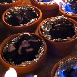 Tabletop s'mores!! Just light charcoal in terra cotta pots lined with foil. So s'mple and s'mart!