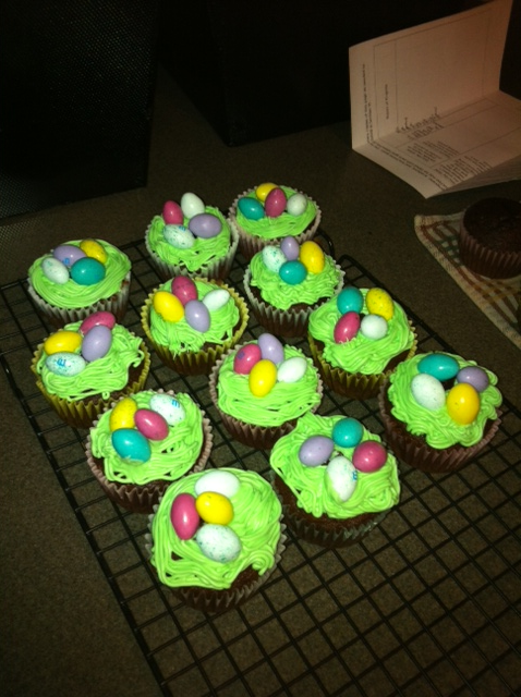 EASTER NEST CUPCAKES I decided to something a little different this year for Easter.  Instead of making the usual white cake with coconut, I decided to make these Easter Nest cupcakes.  My granddaughter really loved them.  I started off with a chocolate box cake mix and made the cupcakes.  For the frosting, I used a basic buttercream and tinted it green with Wilton gel food coloring.  I used the grass/hair tip and made the nest.  I then took Peanut Butter M&M Eggs and put them in the nests.