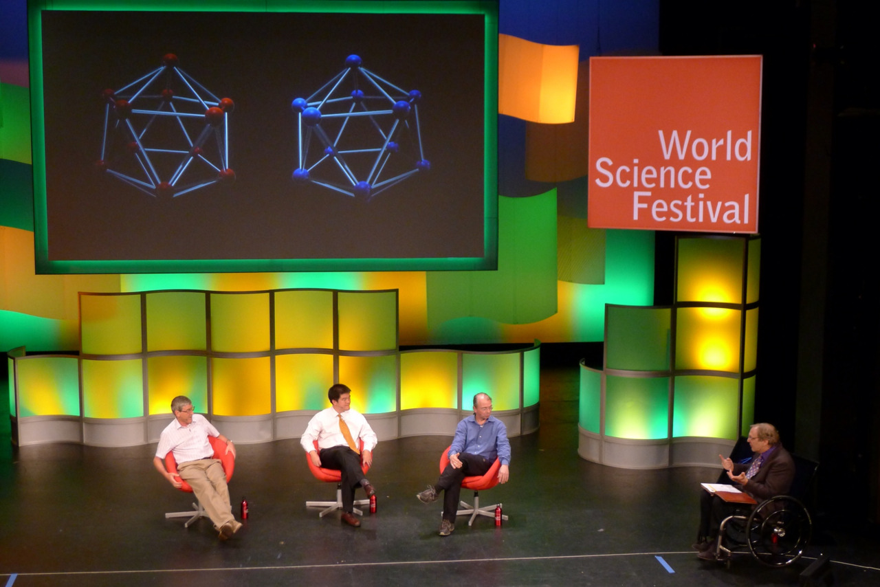 "Hockenberry Steals the Show at the World Science Festival by Colleen Scheck, APM producer  ""Once God saw quantum mechanics, he smiled."" —Thorsten Ritz, biophysicist  I highly recommend watching the stream of last night's World Science Festival event ""Quantum Biology and the Hidden Nature of Nature."" It's rare that a moderator steals the show — especially when sharing the stage with the engaging, brilliant and distinguished minds of Paul Davies, Seth Lloyd, and Thorsten Ritz — but journalist John Hockenberry did it. Through the insights of these three scientific guides, Hockenberry took the professed ""QB"" crowd on a fun journey through the ""spooky"" intersection of quantum mechanics and biology, exploring how it might explain bird migration, photosynthesis, and the delicate sense of smell. God only came up once, after Hockenberry abandoned a complicated question and said ""Let's forget all that. Is there a God?"" Ritz replied, ""Once God saw quantum mechanics, he smiled."" I guarantee you'll be both fascinated and entertained by this event, and perhaps you'll wish, like me, that this is how you had been taught science in school."