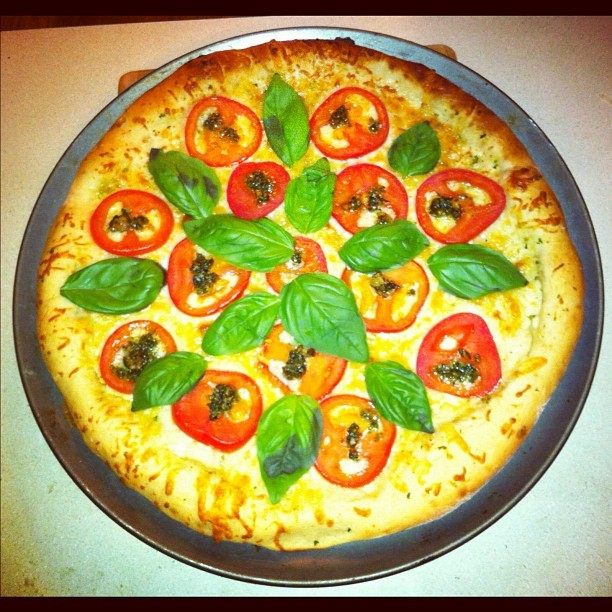 Homemade White Cheddar Pizza with Jersey Tomatoes, Fresh Basil, and Arugula Pesto (Taken with instagram)