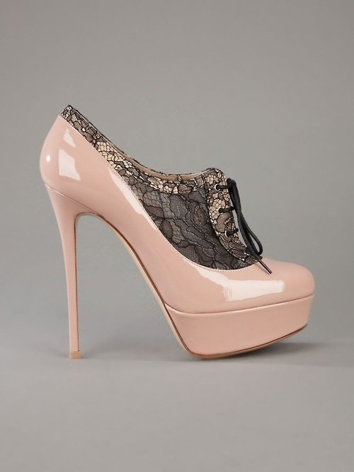 bridalsnob:  Alexander McQueen sexy heels.  No. You would die in these. Seriously, I don't know any bride that could wear this AND handle the train of the gown, her strapless bra and a new mother-in-law all at once. Stay safe, just go with the UGG wedding boots.
