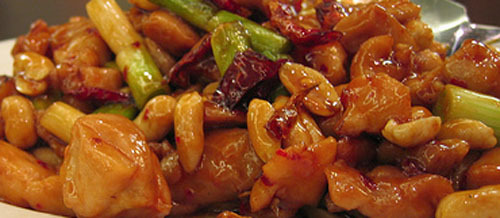 Kung Pao chicken  A hot and spicy Chinese classic that you will not be able to keep your chopsticks out of. What you need 500 skinless chicken breasts cubed 1 tablespoon maizena 2 spring onions chopped 2 Tablespoons chili-garlic paste 4 dry red chilies halved 1 teaspoon finely grated fresh ginger 2 tablespoons chinese rice wine 2 tablespoons soy sauce 2 teaspoons sugar palm of roasted unsalted peanuts The process Dust the chicken pieces with maizena and toss the pieces around until the are all coated. Heat a wok/frying pan with oil and stir fry the chicken pieces for about 5 minutes, they should be almost cooked through. Add the onions, chilies and ginger and toss a few times to combine and remove from the pan. Add the rice wine, soy sauce, sugar and garlic chili paste to the wok and stir well to form a uniform sauce. Add the chicken back to the pan then the peanuts and stir to coat all of the pieces with the sauce for about 2-3 minutes. Serve immediately with steamed/boiled rice.