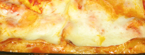 Creamy chicken lasagna  Lasagna has become one of my favorite dishes this winter and this is a really nice variation. You can add cream for a really rich sauce. (Good for 6 people) What you need Olive oil and butter for frying 750g cooked and sliced chicken breasts 1 onion diced 1 cup pasta marinara sauce 1 teaspoon minced garlic 1 cup grated mozzarella cheese 1 cup cheddar grated cheese Salt and pepper to taste 1 1/2 boxes par cooked lasagna sheets Salt and pepper to taste The process In a frying pan with some olive oil and a little butter, cook the onions until soft and add the garlic. Add the cooked chicken and salt and pepper to taste. You can add the chicken breasts uncooked at this stage and cook until white. Now add the pasta marinara sauce or similar tomato sauce of your choice and about 125ml cream if you need real comfort food. Your pasta should be boiled for about 7 minutes before you begin constructing the lasagna. Butter a baking dish well and put 1 layer of pasta on the bottom, then a layer of the chicken sauce mixture and sprinkle over a layer of cheese. Repeat until you reach the top of the dish and finish with a layer of pasta, Top with the remaining cheese and set in a 180 Celsius oven for 30 minutes or until the cheese is melted and slightly browned in places. YUM!