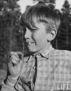 Young boy smoking a cigarette Photographer: Mark Kauffman Children's Village For Troubled Children, Stockholm, Sweden, May 1949. © Time Inc.
