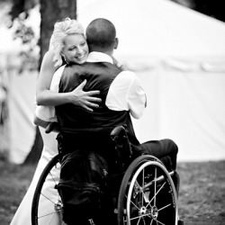 A first look moment between a bride and her groom who was recently paralyzed in an accident and confined to a wheelchair.