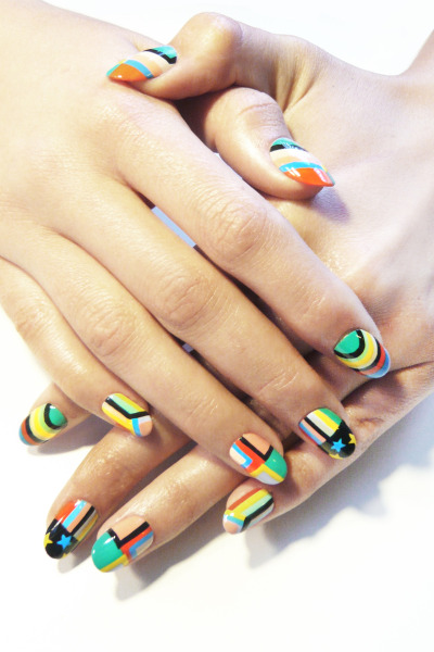 @MPNails creates an amazing rainbow brights mani for summer using @kissusa