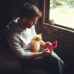 Husbeard and kittybaby, starting the day off right with a smoke and some gameboy #Husbeard #man #beard #glasses #husband #lover #cat #kitten #gameboy #morning #buddies  (Taken with instagram)