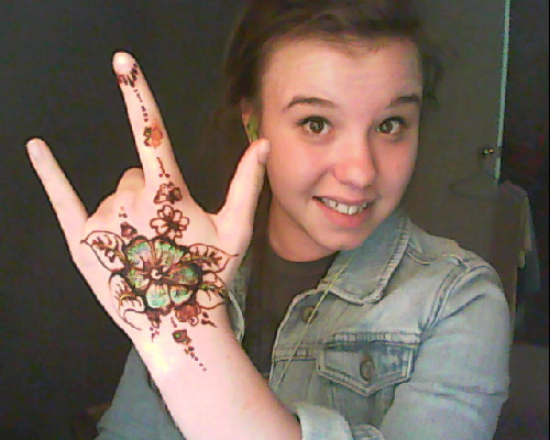Sweet henna at the peacefest 2012:D Totally smudged the flower on my finger though:P