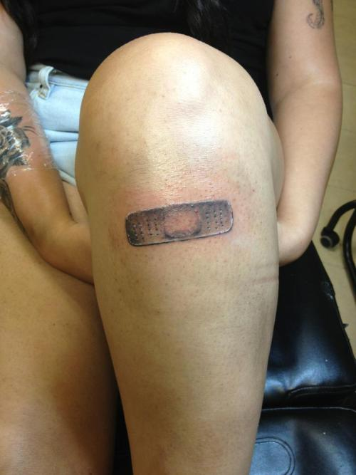 Great bandaid tattoo on the knee via fuckyeahtattoos:  a simple bandaid on me knee to symbolize my strength over the years… and my randomness. i got it done by manny at artery tattoo and body piercing in palm city, florida. he does amazing work. http://cryandcurse.tumblr.com