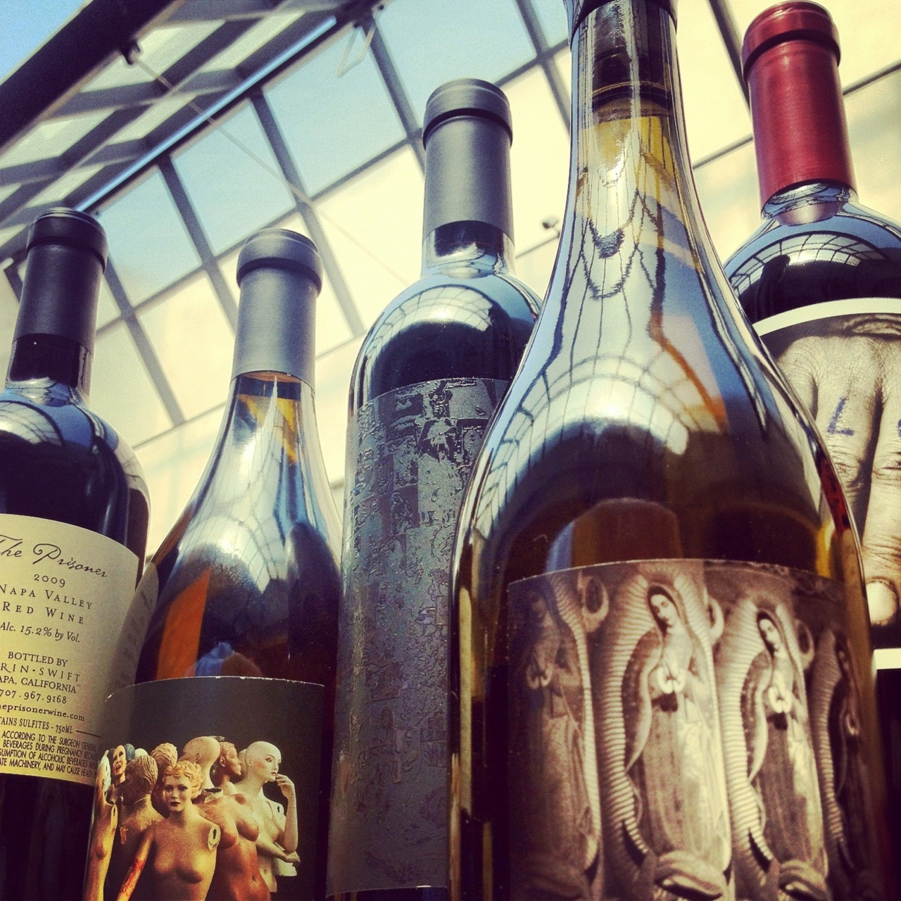 We are proud to exclusively carry Orin Swift wines on our Reserve Wine List.  These cult small batch wines by master winemaker Dave Phinney have been described as very flavor forward with striking and beautiful blends that cannot be missed.  Besides the artistry of the wine itself, the bottles also boast some pretty incredible and provoking artwork.   A perfect pairing for our eclectic small plate menu selection.  www.orinswift.com Cheers