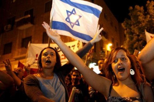 "thepeoplesrecord:  Here's What's Happening Now in Israel!  June 02, 2012 Today in Israel, thousands took to the street in at least three of Israel's largest cities, another sign that the energy and organization of last year's broad protest movement in Israel is reigniting. More than 5,000 took to the streets in Tel Aviv, Saturday's largest protest. Protesters were seen holding signs with messages like ""Capitalism isn't kosher,"" and ""The people demand social justice!"" The 2011 Israeli Social Justice Protest Movement From July to October of 2011, hundreds of thousands took place in regular protests in Israel often referred to as the ""2011 Israeli social justice protests."" In August and September of 2011, exploded with much larger protests and public support with their tent encampments. The protests paralleled the Occupy Movement and are sometimes included in the movement, referred to as ""Occupy Israel,"" and ""Occupy Tel Aviv."" Whatever the title, the movement expresses the same kind of dissatisfaction with capitalism, the status quo and institutionalized social injustice. 2012 Like the Occupy Movement, things have been quieter for the Israeli Social Justice Movement in 2012 than they were in the second half of 2011. However, over the last month the movement has conducted several coordinated protests, each gaining momentum and progressively getting larger. Today marks the largest coordinated protests from the movement since October of last year. -R.Cunningham See more ""Happening Now!"" posts from thepeoplesrecord.com."