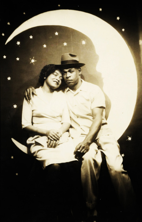 1940's couple on a paper moon
