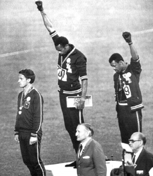 fyeah-history:  The 1968 Olympics Black Power Salute: African American athletes Tommie Smith and John Carlos raise their fists in a gesture of solidarity at the 1968 Olympic games. Australian Silver medalist Peter Norman wore an Olympic Project for Human Rights badge in support of their protest. Both Americans were expelled from the games as a result       (via TumbleOn)
