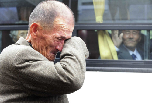 A North Korean man waves his hand as a South Korean relative weeps, following a luncheon meeting during inter-Korean temporary family reunions at Mount Kumgang resort October 31, 2010Four hundred and thirty-six South Koreans were allowed to spend three days in North Korea to meet their 97 North Korean relatives, whom they had been separated from since the 1950-53 war.