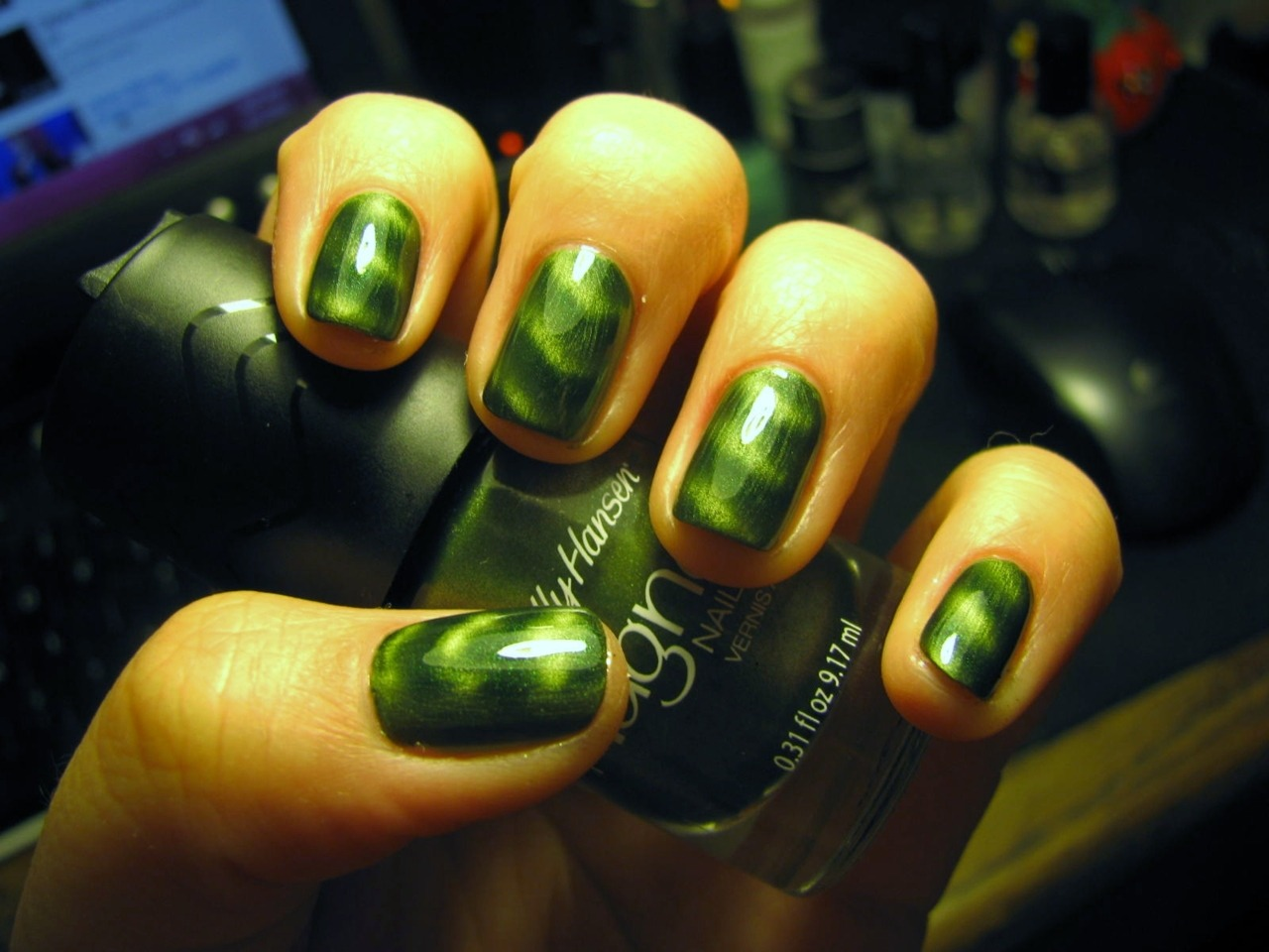 Sally Hansen Magnetic nail color in Electric Emerald. Applies really well and super easy to use.