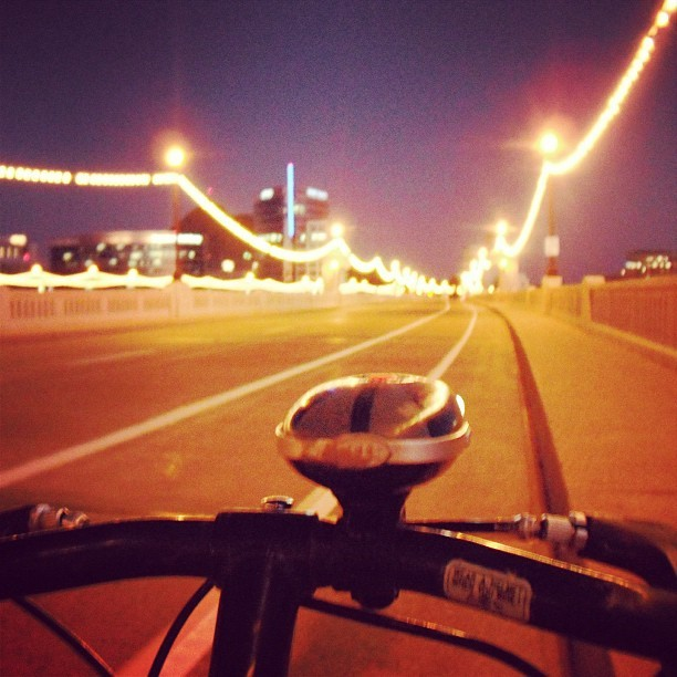 Crossing the #MillAve Bridge in #Tempe #Arizona at dusk. That headlight was stolen one day while my #bike was parked. #bicycling #asu (Taken with instagram)