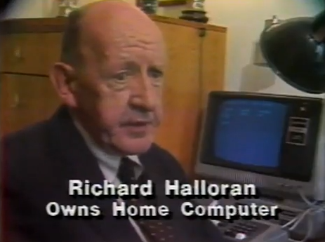 "This ""ha ha, can you believe that owning a home computer was exotic once?"" screen capture going about is sorta nostalgic to me: the home computer Richard Halloran owns—there in the background—is the first one I owned, a TRS-80 Model I. The computer itself is in the keyboard, but the thing the ugly monitor is sitting on is the ""expansion interface,"" necessary if you want to triple the memory all the way from 16K to 48K (note that is ""K,"" not ""G"" or even ""M"") and have disk drive (5.25″ floppies). A Model I so equipped, with one floppy drive, would have run you $1945.  I only say ""sorta"" nostalgic because, like most old computer technology, you only miss it until you try using it again, even in emulation. It does make one wonder what, thirty years from now, will make our current gadgets seem as antiquated as Richard Halloran's amazing machine."