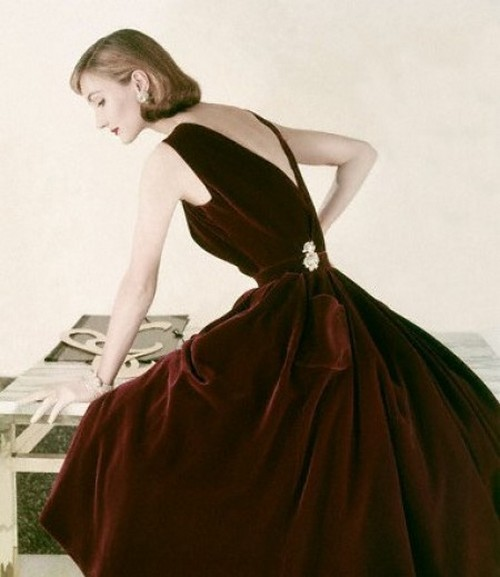 theniftyfifties:  Evelyn Tripp in a velvet gown for Vogue, 1955.