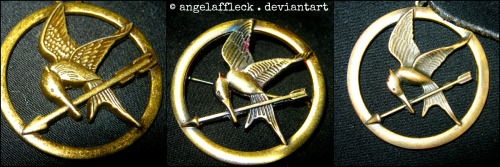 Taken by me  I'm adding on to my lovely Mockingjay pendants. Sadly, I don't really want the new Mockingjay pin because it's so tiny compared to my Mockingjay brooch. But, I'll add on more once I buy the DVD and Digital Copy set when it comes out since it comes with a new Mockingjay pendant. :D  It's really cool seeing all the differences amongst all three of these lovely accessories. http://angelaffleck.deviantart.com/