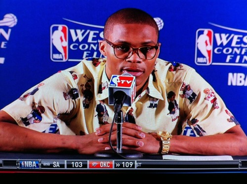 Russell Westbrook sports a teddy bear dress shirt and gold watch during his post-game presser. Not pictured, his red pants.