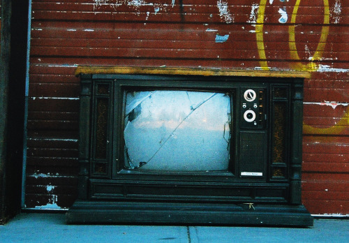Old Television outside some warehouse. Manchester NH.