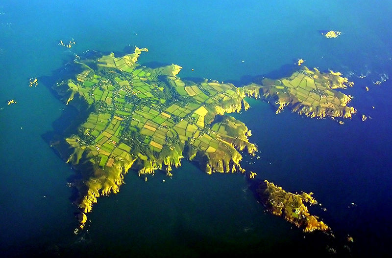"Dark Sky Island The gorgeous Isle of Sark, the smallest self-governing island in Europe, is located in the English channel 130 miles off the southern English coast. In January 2011 it became the world's first ""Dark Sky island"" by controlling light pollution. The island's single electricity source is an oil-fired power station, and there are no cars, streetlights or even paved roads: you can only get around by bike, horse, carriage or tractor-drawn bus. Due to the lack of light pollution, the Milky Way stretches gloriously overhead—from horizon to horizon across the pristine black sky."