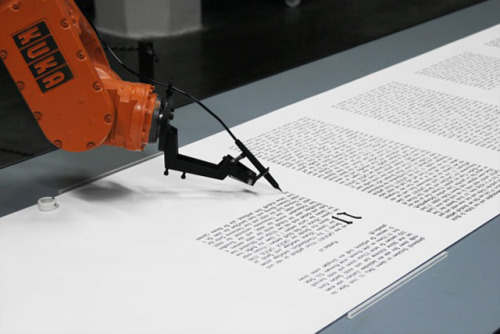 The installation 'bios [bible]' (2007) by Robotlab consists of an industrial robot which writes down the bible on rolls of paper.  The machine draws the calligraphic lines with high precision - like a monk in the scriptorium.