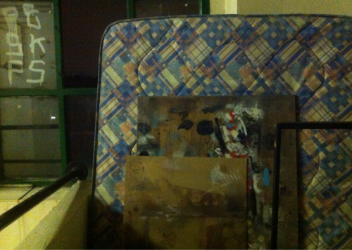 Mattress with art boards, 4th floor rainy night. Bragging about my old two tier bed platform. Belfast Road.