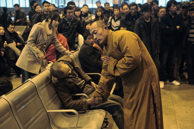Buddhist Monk blesses a man who suddenly dies while waiting for the train.