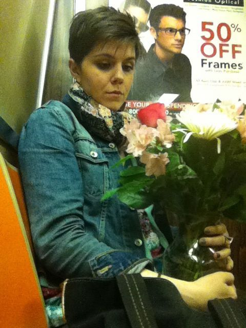 Unknown time (after work). Friday - taking my birthday flowers home on the train.