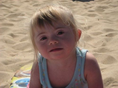 youramberanon:  This little girl right here is my cousin, Madison. She was born with down syndrome. Everyday after kindergarten she comes home crying because people say she looks weird or she shouldn't have no friends because she's ugly. It so heart breaking to hear Her talk about how she wants to be 'pretty like the other girls.' please reblog so I can show her that people think she's beautiful the way she is.