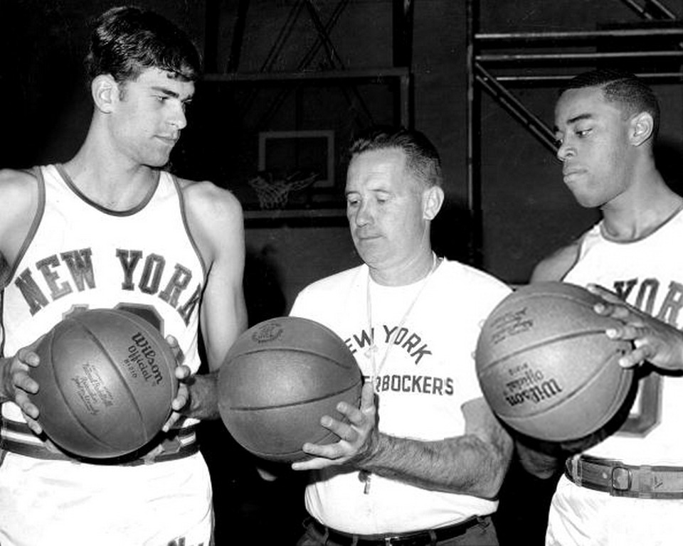 Knicks' coach Dick McGuire welcomes Phil Jackson and Walt Frazier to training camp. (1967)