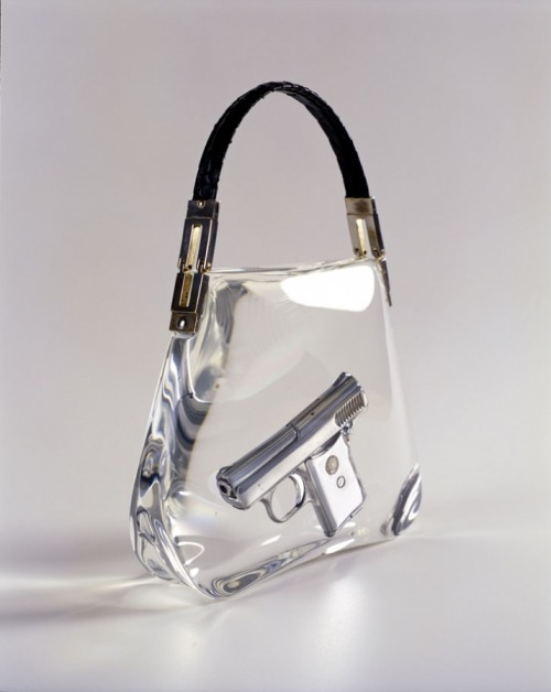 ipocrisia:  Ted Noten Superbitch Bag 2000 Work: Gun casted in acrylic, snake skin handle Dimensions: 23x22x7cm