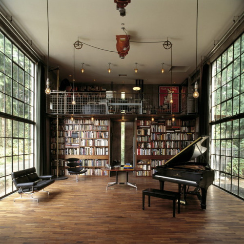 Love the library - a wall of books flanked by floor to ceiling windows (via S T R O N G P L A C E: Olson Kundig Architects)