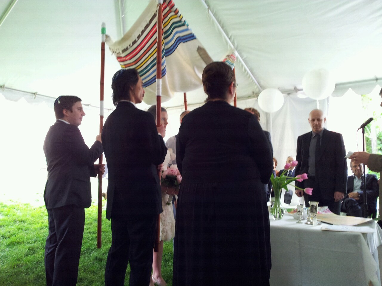 Mazel tov! Gee, standing there the whole time holding up the chuppah really makes your back tense.