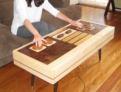 "razorshapes:  Charles Lushear's etsy. ""Nintendo NES controller coffee table. Made from maple, mahogany and walnut with dovetail joinery and mid century modern legs. This table fully functions as a Nintendo NES controller and can be used to play games with the glass removed. The cord is retractable from underneath. """