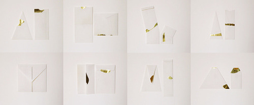 "The Golden Set / 15 Handmade Paper Envelopes / 2011 by Furze Chan. ""The definition of an envelope was redefined as:  An enclosed paper pocket with one or more openings. Under this definition, experiments were carried out to explore the possibility of envelope forms, disregarding their functional usage.  Hand-torn golden paper pieces were applied onto geometrically shaped white envelopes. The envelope paper is vintage typing paper."""