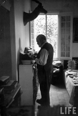theparisreview:  workspaces:  Ernest Hemingway's standing desk:  A working habit he has had from the beginning, Hemingway stands when he writes. He stands in a pair of his oversized loafers on the worn skin of a lesser kudu — the typewriter and the reading board chest-high opposite him. - Paris Review, 1958  via kottke  Some old habits never die.