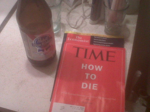 "a bit of juxtaposing i had to do at a friend's apt. last night: time's cover ""how to die"" and the economist and a PBR 40."